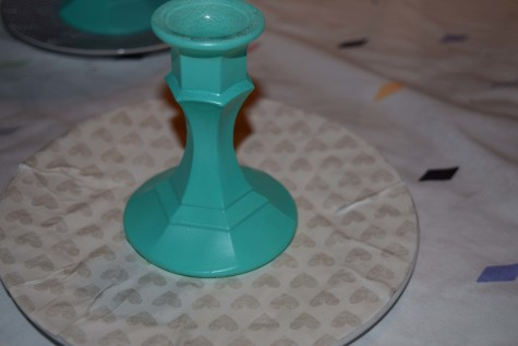 Hot glue each candle stick to the plate.