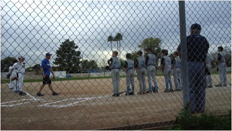 The players of both teams meet around the baseball diamond, encouraging fair sportsmanship. The Horizon Honors' Eagles won with a score 13 runs to three.
