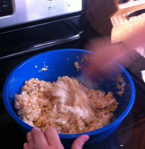 3. Add 6 cups of Rice Krispies to the melted marshmallows.
