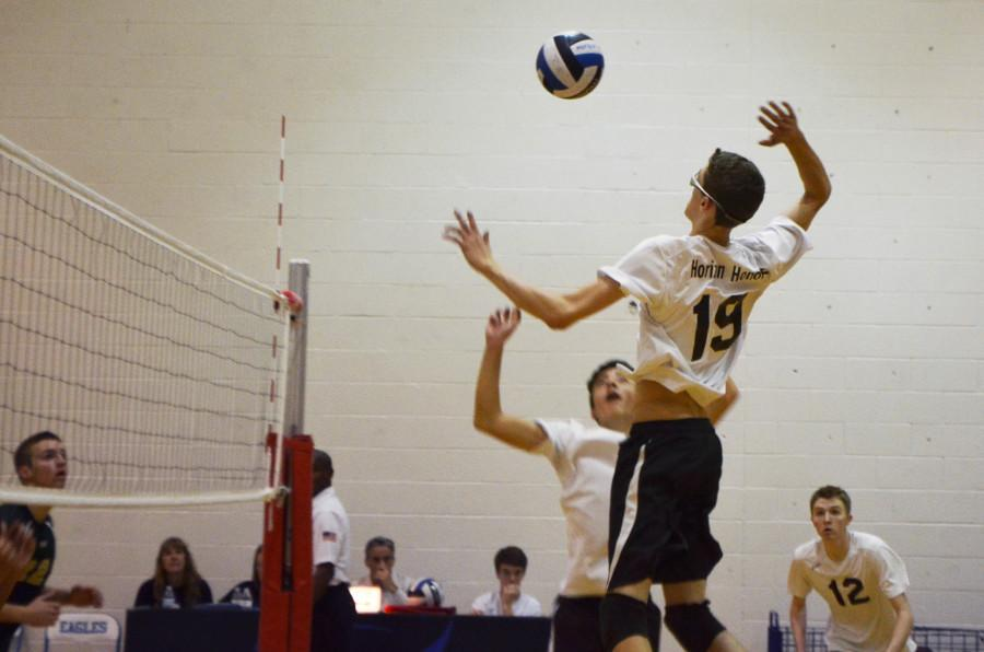 Sophomore Trevor Weary jumps to spike the ball to the other side of the court.