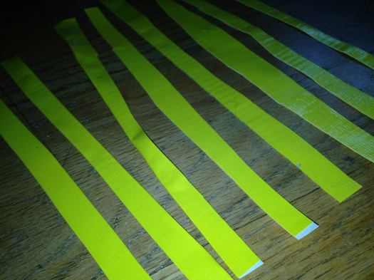 Place the sticky sides of two pieces of duct tape together like before to create sheets of duct tape. Then cut the sheet into thin strips--the amount is your choice.