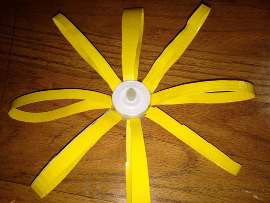 If needed, bend the duct tape outwards to create more of a daisy-like shape. But otherwise, you have completed your third flower.
