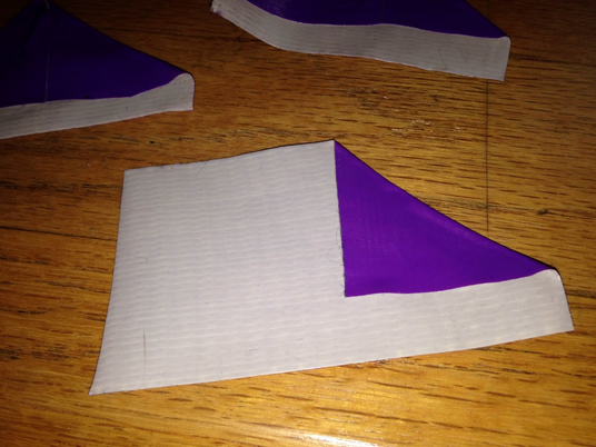 Take the pieces you just cut out and fold the top corners inward so the edges touch, creating a triangle-like shape.