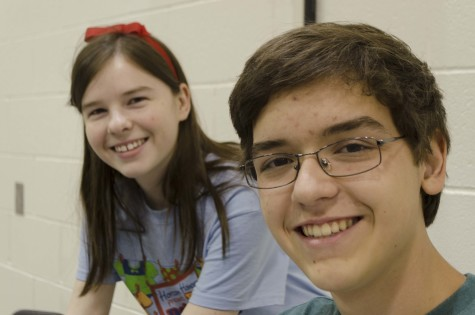 """Tech crew members Claire Bennett and Connor Lowe get set up for """"The Pajama Game."""""""