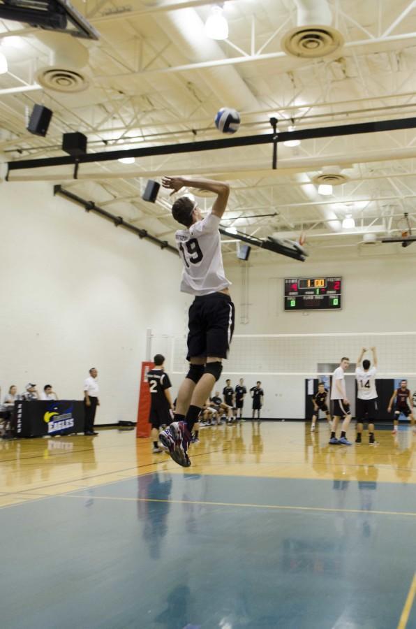 Senior Trevor Weary serving the ball.