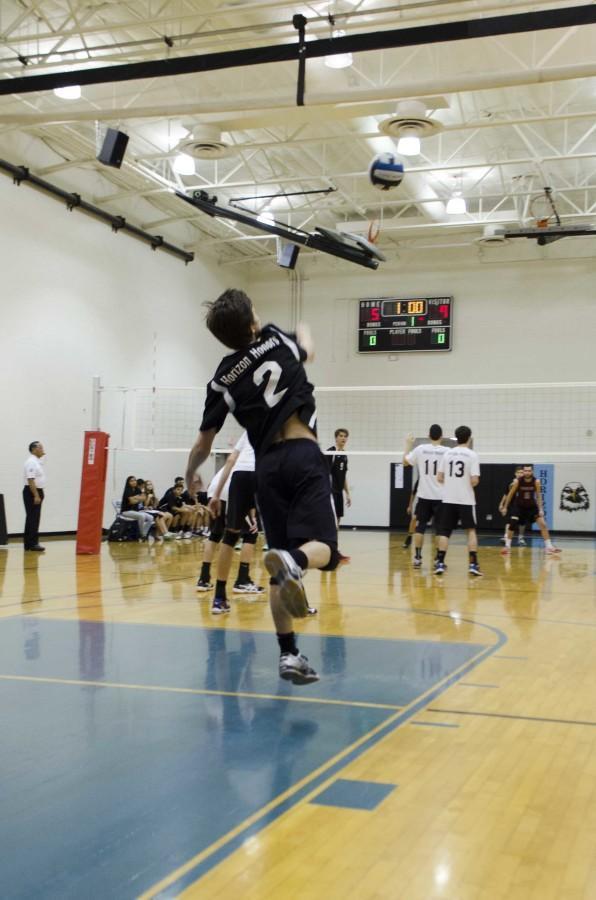 Senior Tony Salatino serving the ball.