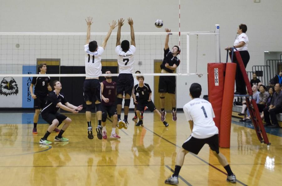 Senior James Tsai and sophomore  Nathan Hernandez jump to block the ball.