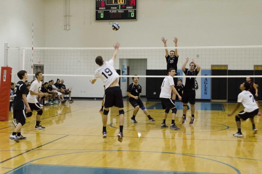 Senior Trevor Weary spikes the ball to the other side.