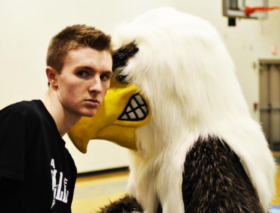 Patrick McPherson takes advice from the Eagle. Taken before commencement of pep Rally.