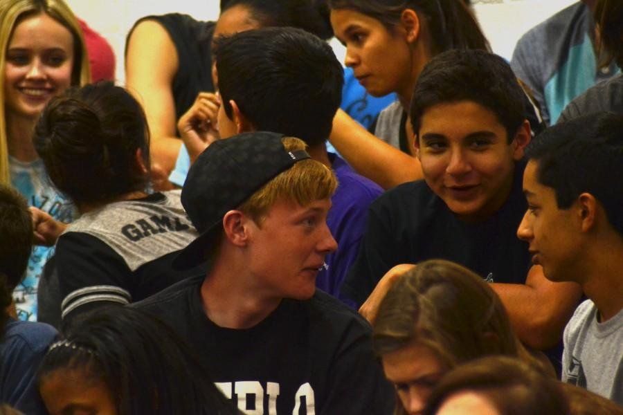 Students talk to each other during the Pep Rally, which took about 45 minutes.