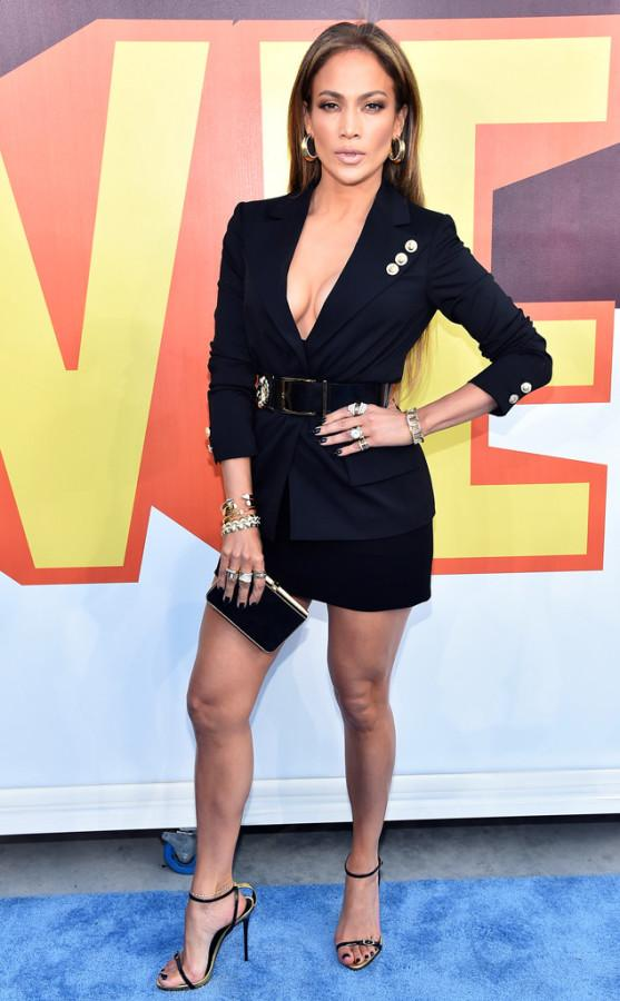 Jennifer Lopez: JLo has once again rocked the red carpet in a Versace power suit, slicked back hair, and a black clutch with gold lining. The actress and singer did not perform, but did get to take home yet another Golden Popcorn award.