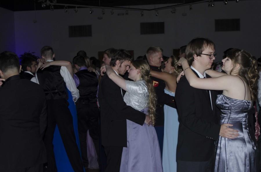 Many couples at prom enjoyed slow dances.