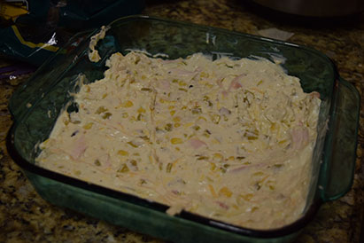 On top of the corn tortillas spread the shredded chicken on top, followed by the creamy mix.