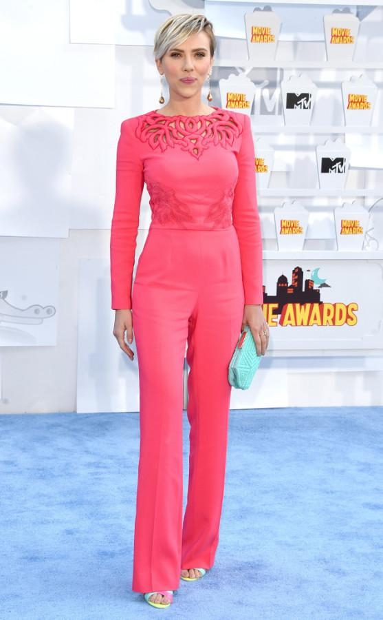 """Scarlett Johansson: The actress who starred in """"Lucy"""" wowed the crowd with a pink jumpsuit from Zuhair Murad. She had also finished her look with colorful Sophia Webster heels and an aqua clutch."""