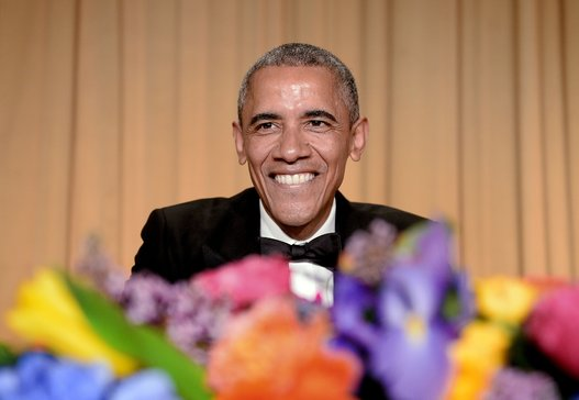 Barack Obama smiling at the audience during the Correspondents' Dinner 2015. His speech was childish, yet brought up some important ideas about government and other matters of importance.