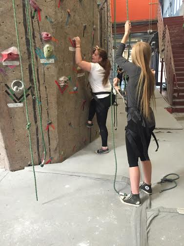 Hannah Wikoff holds the belay for Lucianne Morin to climb.