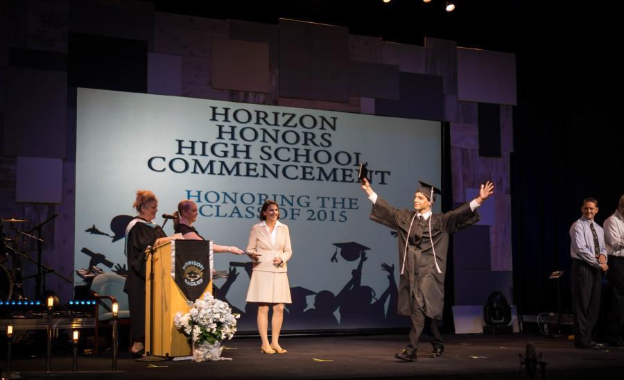 Graduate, Matthew Manzo walks across stage.