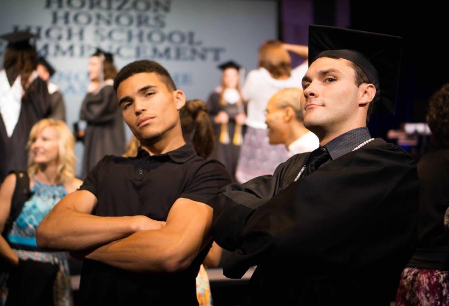 Graduate, Zach Baker, and 2014 graduate, Connor Pendleton pose at the 2015 graduation.