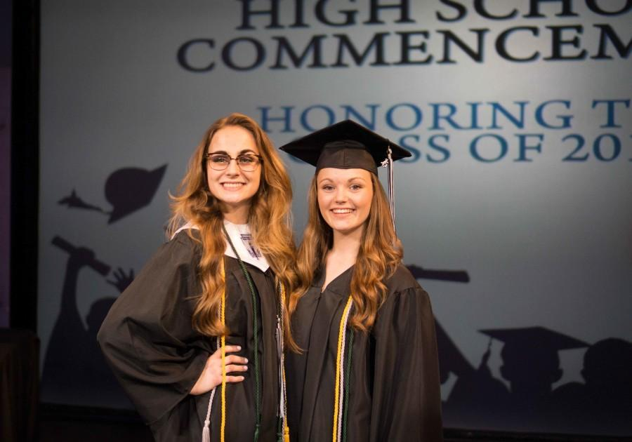 Graduates, Alexa Geidel and Julie Drake pose together.