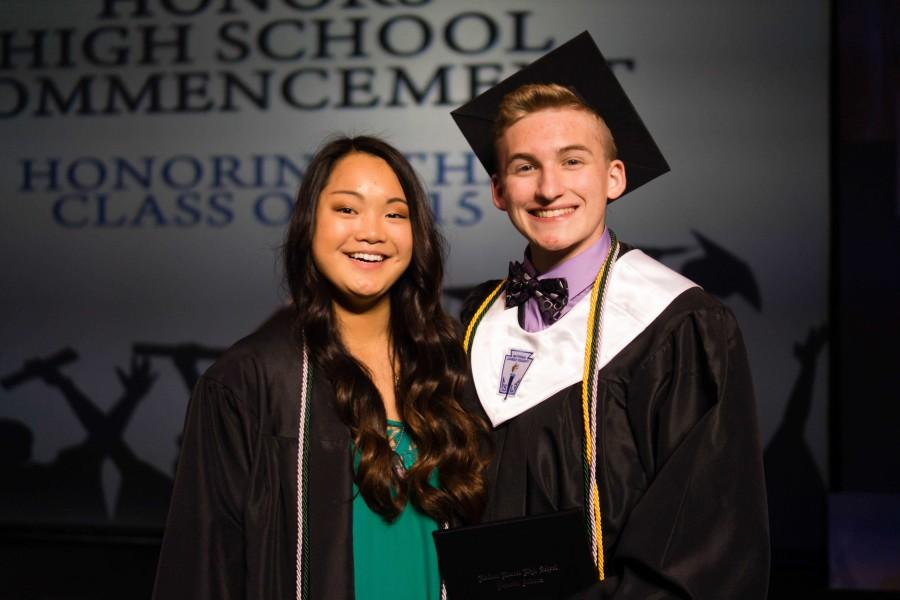 Graduates, Sam Schian and Bennett Wood pose for an after-graduation picture.