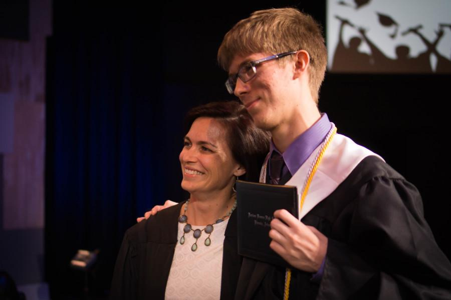 Mrs. Baird and Erik Stahl pose for a picture on stage.