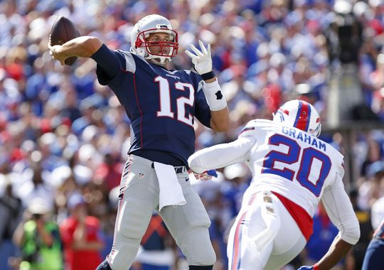 New England Patriots quarterback Tom Brady (12) throws a pass during the Patriots' Week 2 game against the Buffalo Bills. Since having his four-game suspension thrown out, Brady and the Patriots have won both of their games so far.