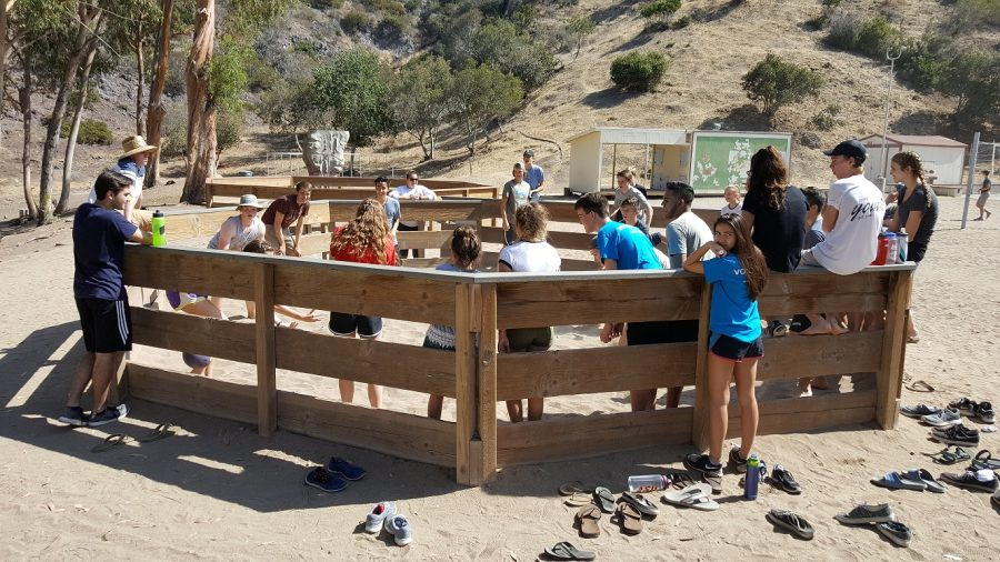 Students gather around for a game of gaga ball.