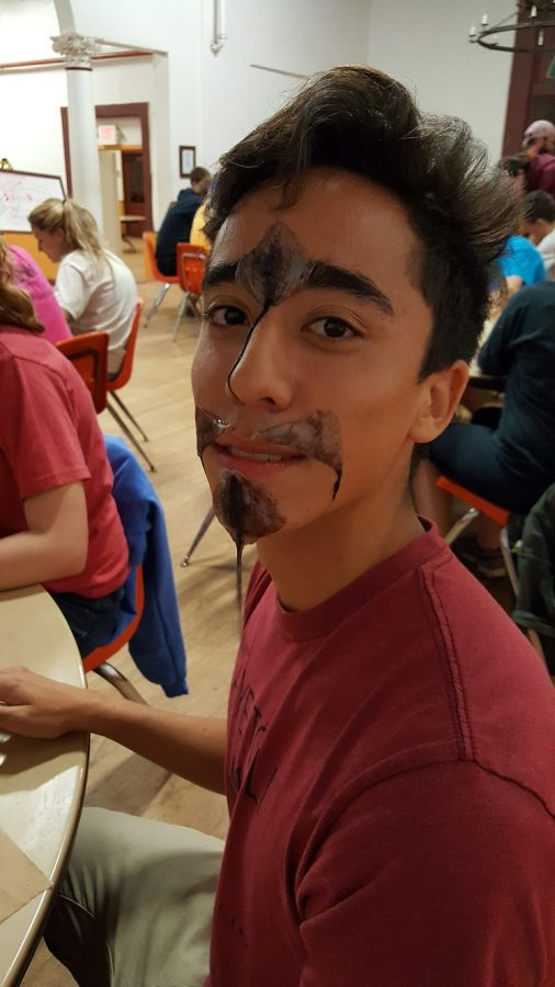 Senior Trevor Tam poses for a photo with squid guts on his face.