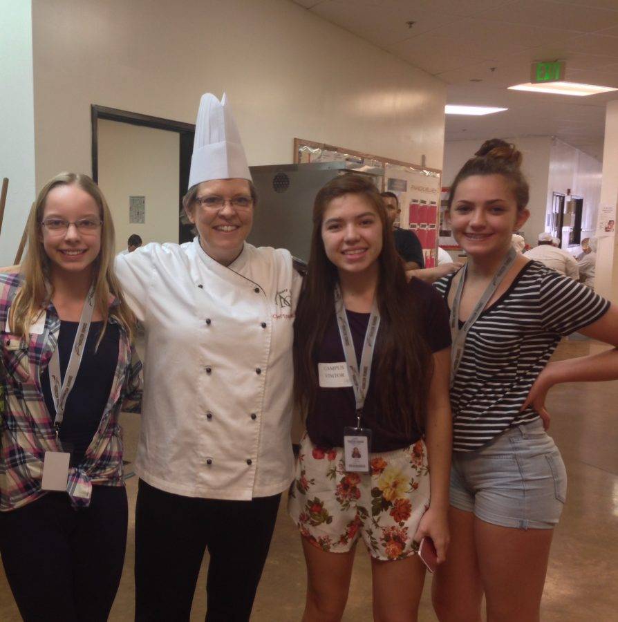 Olivia Hamer, Jana Smyers, and Camryn Dunn took a picture with Chef Tracy Dewitt.