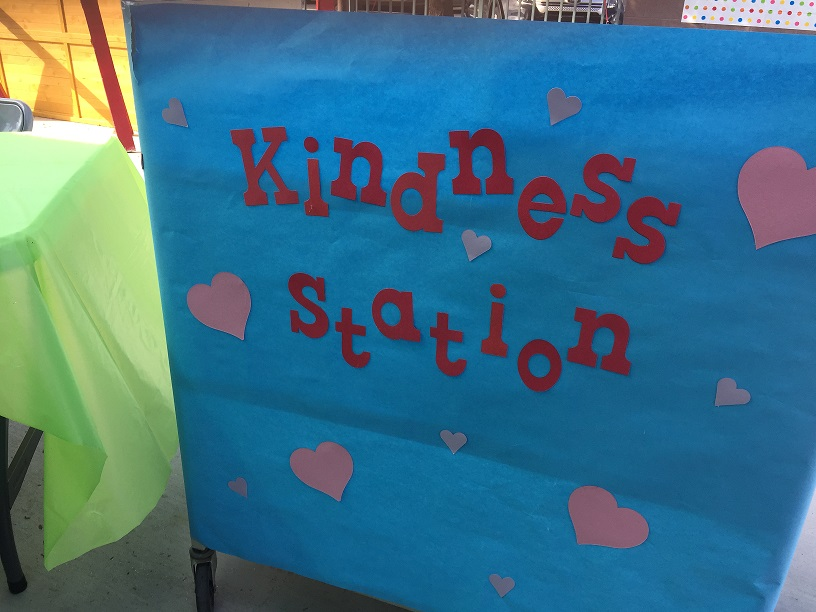 A kindness station in the middle school courtyard was set up by teachers.