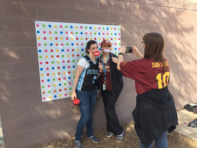 Mrs. Collins, Mrs. Baird, and Mrs. Wallace pose for a photo in the middle school courtyard.