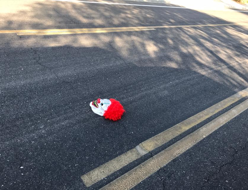 A discarded clown mask found in the street during 2017.