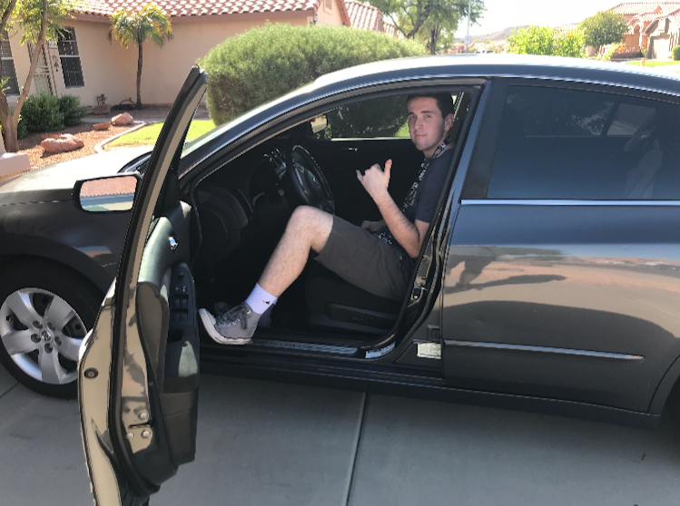 Junior+Ethan+Hurlburt+in+his+car.