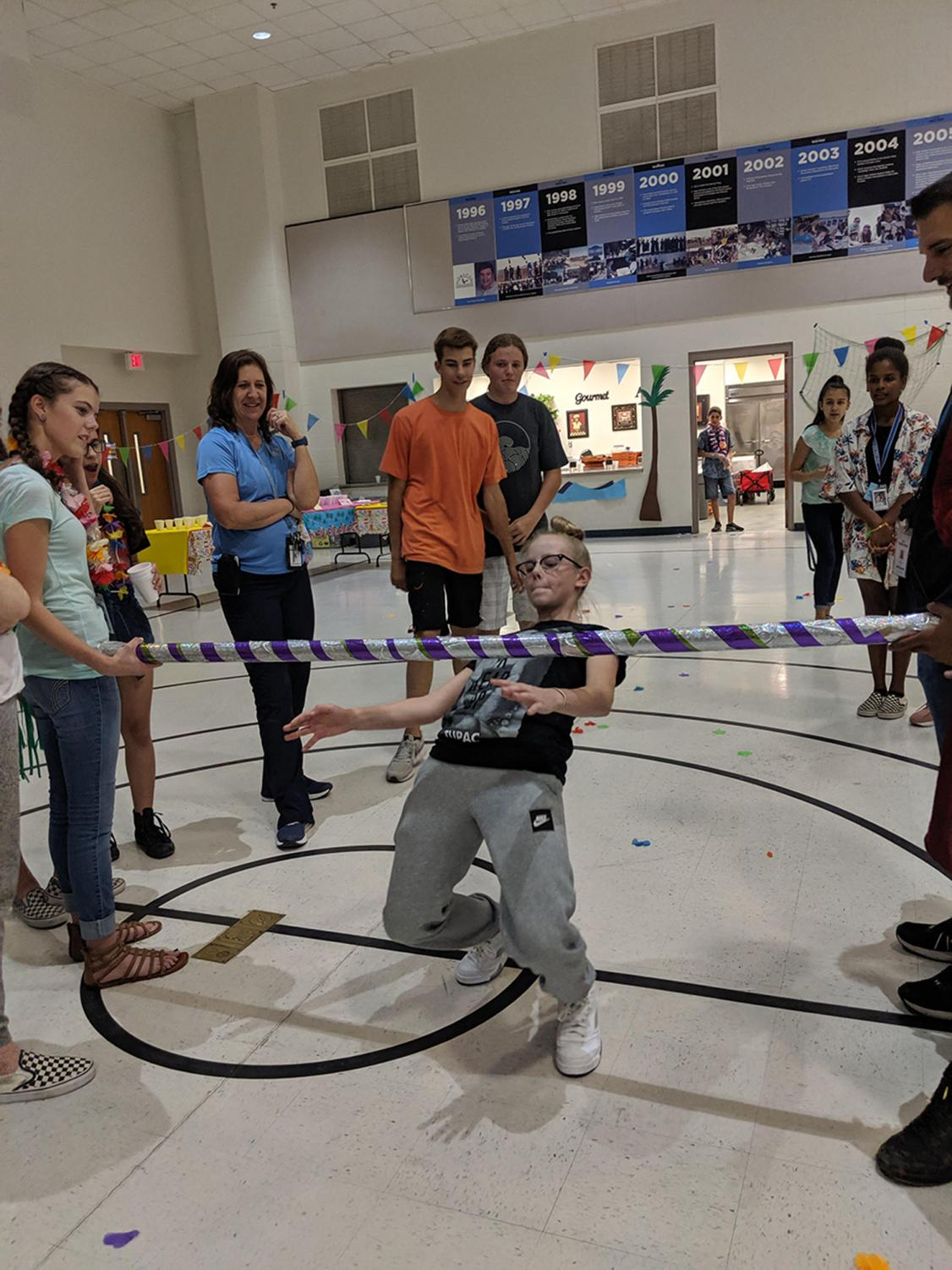 Seventh grader Natalie Ratliff shows off her skills at limbo, winning the competition.