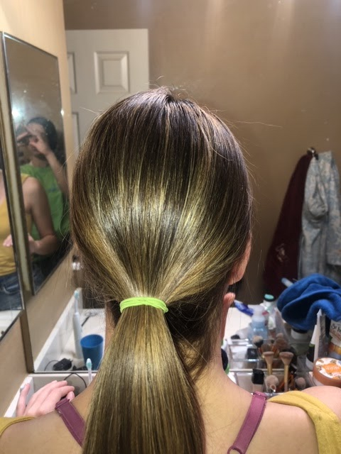 Step+1%3A+Create+a+smooth%2C+low+ponytail.+Brush+out+any+bumps+before+putting+in+the+hair+tie+and+place+tightly+to+avoid+any+hair+falling+out.
