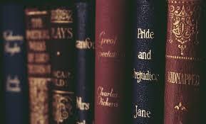 Classic books on a shelf.