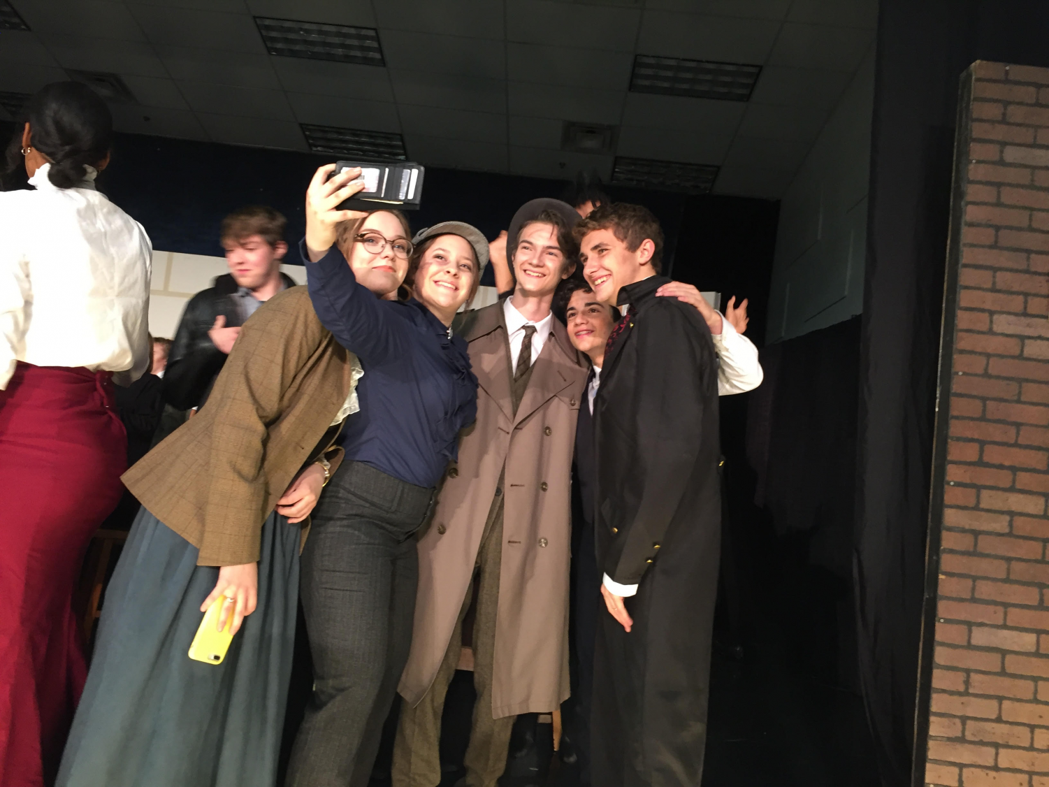 Sherlock Holmes (junior Jocey Price) takes a selfie with her castmates.