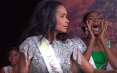 Miss Nigeria cheering on her friend.
