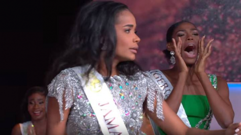 Miss Nigeria cheering on her friend.