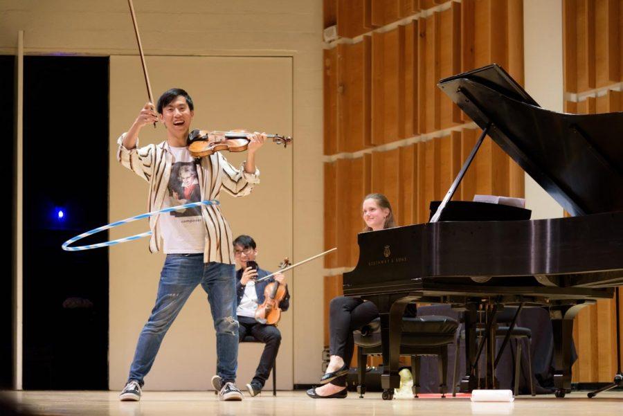 Eddy Chen performing Paganini Caprice No. 24 while hula hooping.