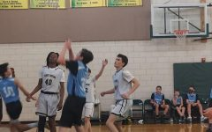 Max Gerelick makes another successful lay-up swiftly followed by a three-point shot by Kenan Christensen, seventh grade.