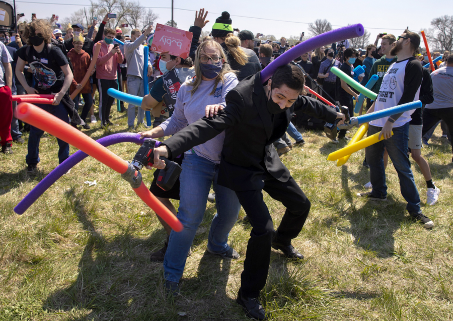 Several Joshes in an intense pool noodle battle.